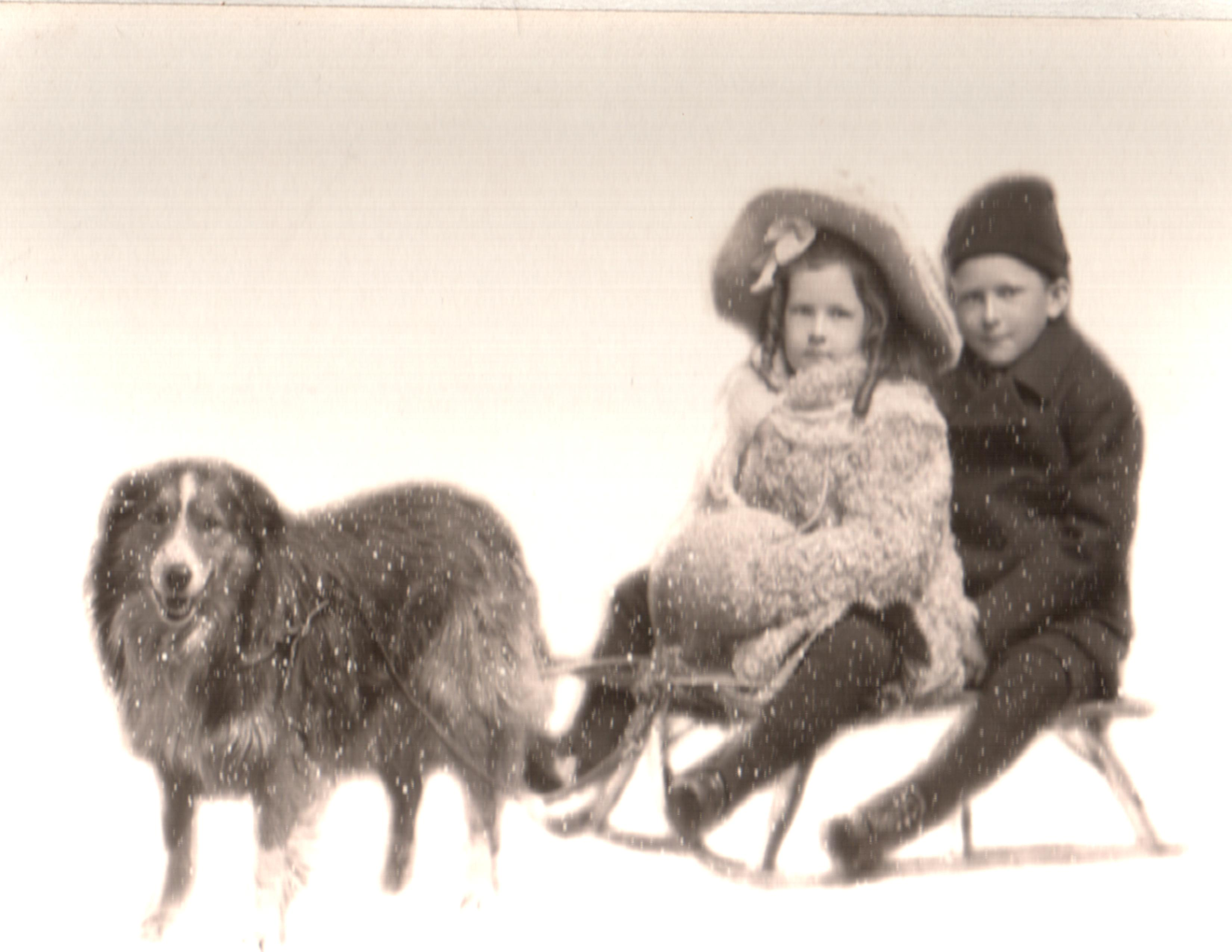 Billy and sister Louise on sled